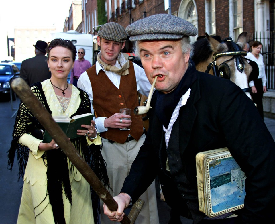 "Actors Suzanne Callaghan (L) Mahon Kelly and Jim Corcoran (R) perform a 'Ulyses' chapter to celebrate Bloomsday in Dublin's city centre, June 16. Thousands of Dubliners turned out to celebrate the city's most famous author on 'Bloomsday' named after Leopold Bloom, the central character of James Joyce's 1922 novel ""Ulysses"", which centres on the single day, June 16 of 1904 in Dublin.    FP/AA - RTR5DK5"