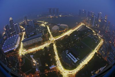 The Marina Bay street circuit is illuminated at dusk after a downpour in Singapore September 11, 2014. The Singapore Formula One Grand Prix night race will take place on September 21, 2014. Picture taken with a fish-eye lens. REUTERS/Edgar Su (SINGAPORE - Tags: SPORT MOTORSPORT CITYSCAPE) - RTR45TEJ