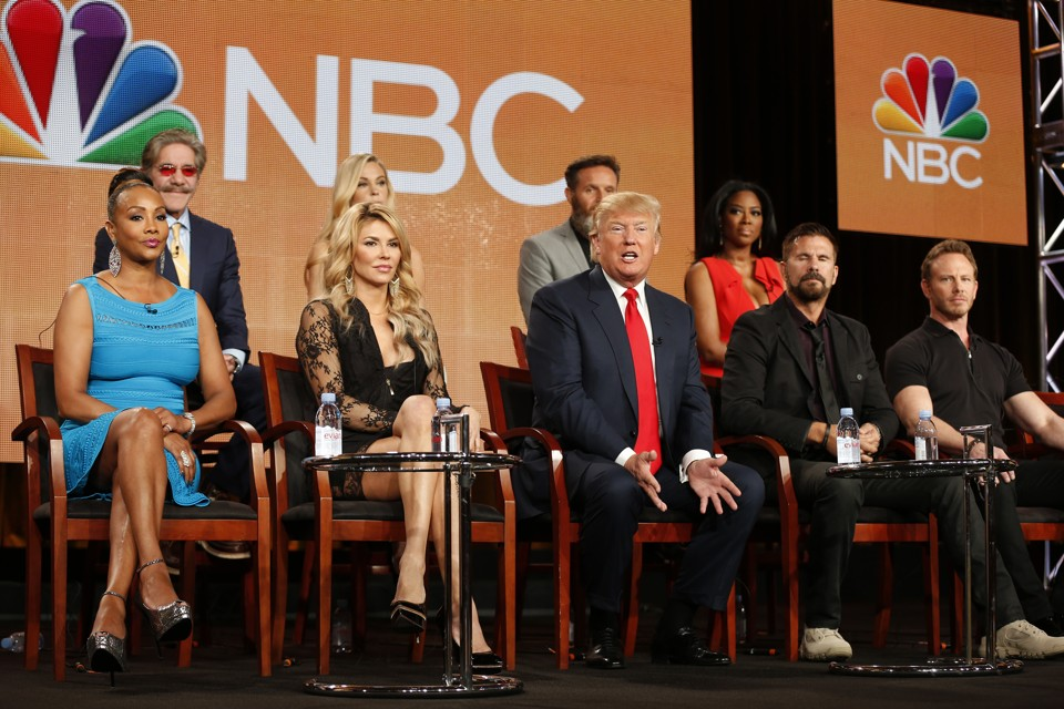 "Executive Producer and host Donald Trump (C) speaks about the NBC television show ""The Celebrity Apprentice"" during the TCA presentations in Pasadena, California, January 16, 2015. Seen (L-R) are other participants Vivica A. Fox, Geraldo Rivera, Brandi Glanville, Kate Gosselin, executive producer Mark Burnett, Donald Trump, Kenya Moore, Lorenzo Lamas and Ian Ziering. REUTERS/Lucy Nicholson (UNITED STATES - Tags: ENTERTAINMENT PROFILE MEDIA BUSINESS) - RTR4LQWC"